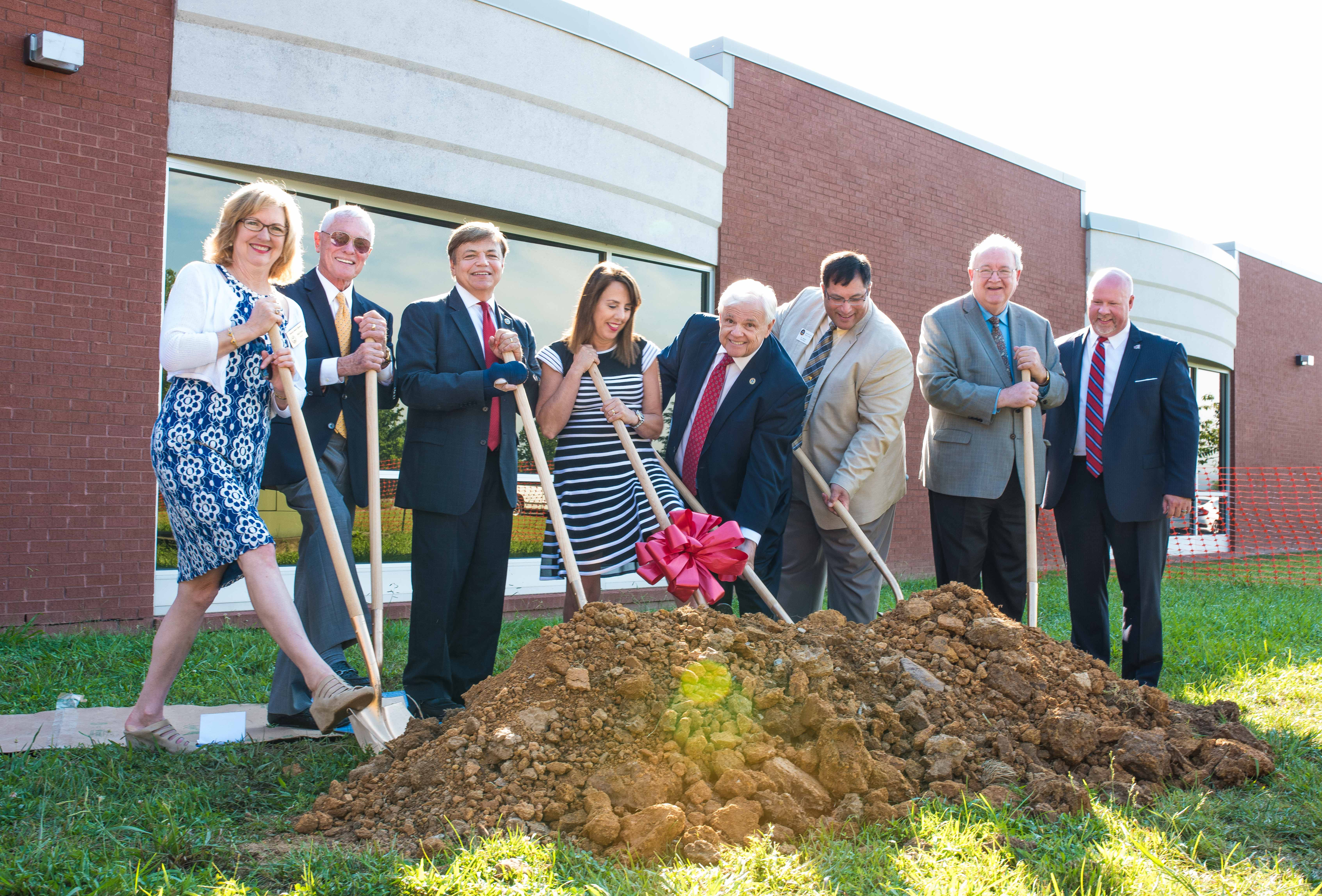 Left to Right: Danni Varland of TBR, Ed Wheeler (Donated the land to RSCC), Rep. Dennis Powers, RSCC Director Tracy Powers, Sen. Ken Yager, Campbell County Mayor E.L. Morton, Bill Vinson of Community Tectonics Architects, and Dr. Chris Whaley of RSCC